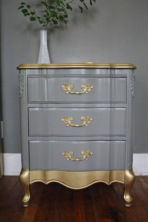 gray and gold giving an old chest of drawers the hip heritage look using