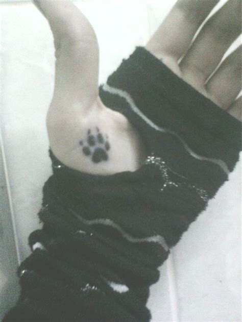 wolf print tattoo best 20 wolf paw tattoos ideas on wolf print