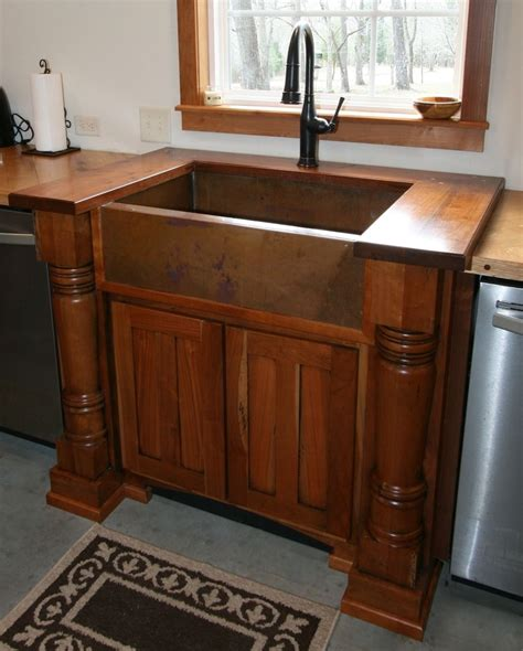 Custom made cherry sink cabinet with walnut top and handcrafted copper