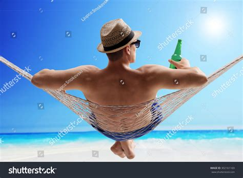 A Relaxed relaxed lying hammock stock photo