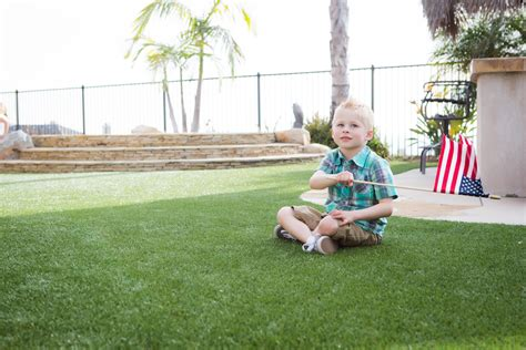 Kids Playing In Backyard Keep Your Kids Safe Happy And Clean With Artificial Turf