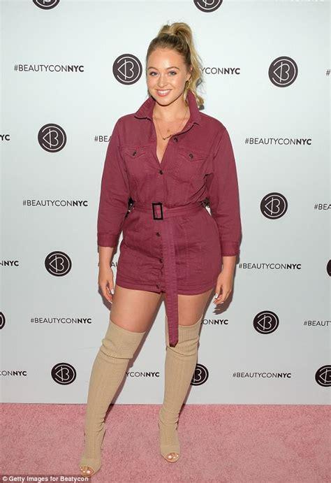 iskra displays legs in a maroon minidress at