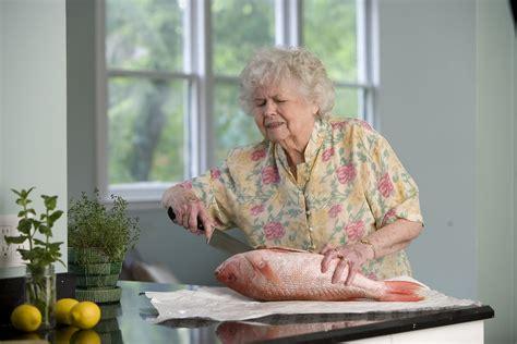 fish food  stock photo  elderly woman preparing