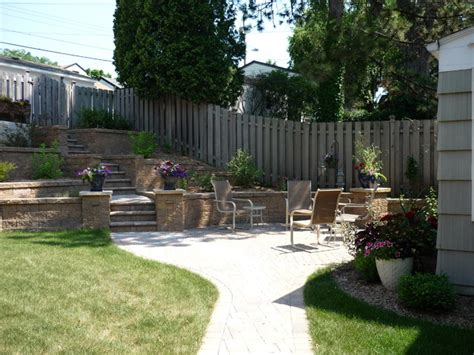 Terraced Backyards by Terraced Backyard With Stairs And Paver Patio