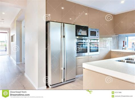 Pantry Kitchen Cabinets - modern refrigerator in the luxury kitchen with microwave ovens stock image image 67217985