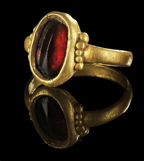 six bid gold and garnet ring 3rd century sixbid