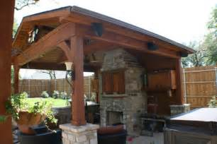 This patio fireplace matches the pillars used to support the cover