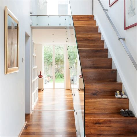Staircase Ideas Uk White Hallway With Walnut And Glass Staircase White Hallway Staircases And Shoe Cubby