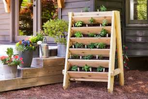 white vertical herb planter featuring bonnie plants