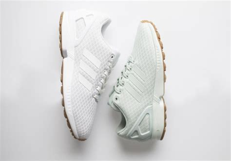 adidas drops a gum sole onto their og flux platypus shoes