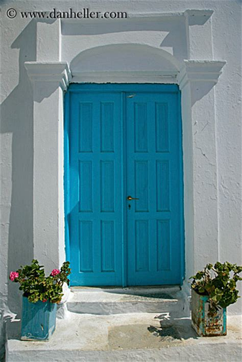 light blue front door light blue door and geraniums 1