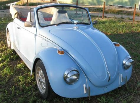 volkswagen bug light blue beetle car light blue