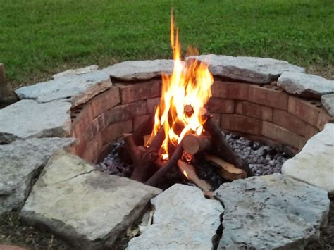 my homemade fire pit cost 0 00 simple and made from repurposed brick and creek rocks with