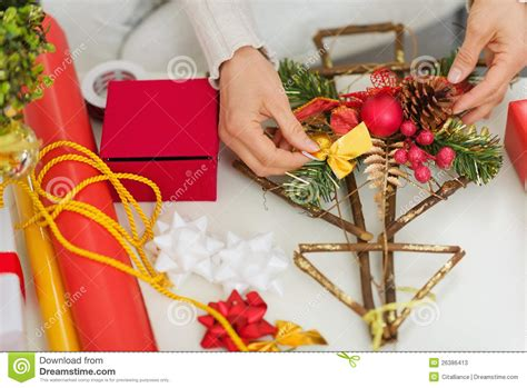 hand making home decoration closeup on hand making christmas decorations stock image