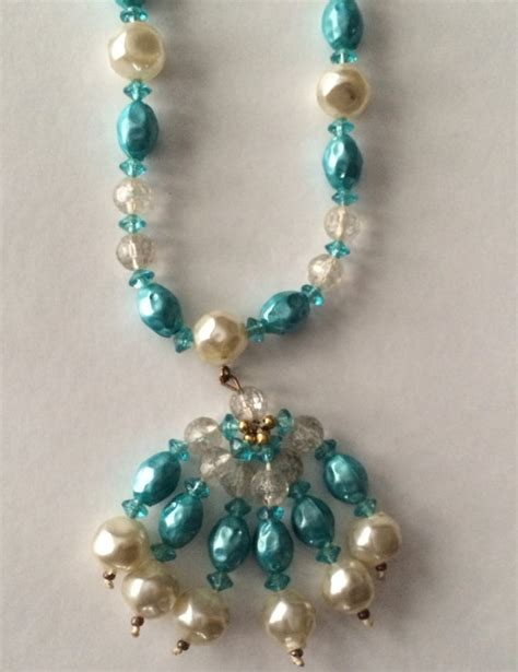 vintage plastic beaded necklace with tassel
