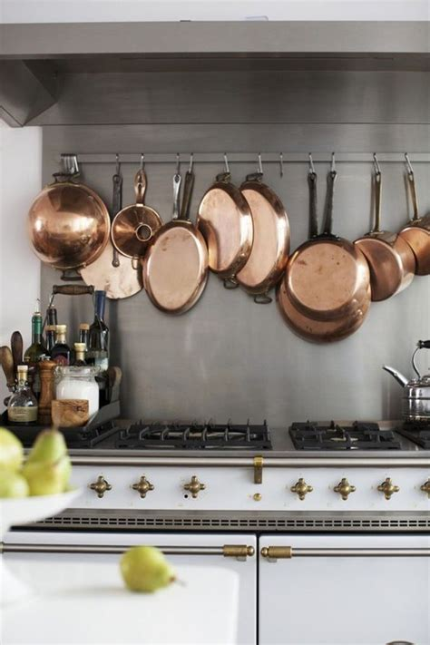 copper pots as kitchen decor remodelista 10 ways to use copper in your kitchen fieldstone hill design