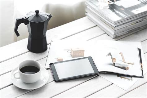 picture coffee mug mobile phone desk book