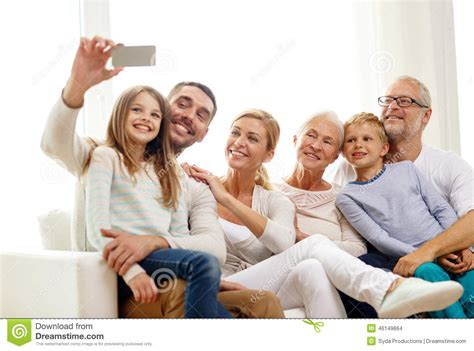 happy family with smartphone at home stock photo image