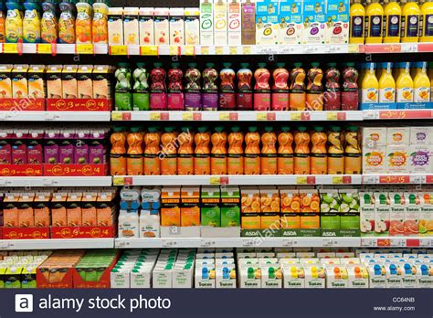 Shelf Of Oranges by Display Of Fruit Juices In Scottish Supermarket Stock