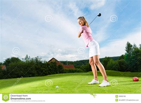 female golf swing female golf player on course doing golf swing royalty free