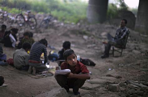 children in indian school brave activist teaches poor for free underneath Poor