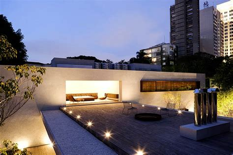 house chimney design the chimney house s open glass curtains let the outdoors in marcio kogan chimney