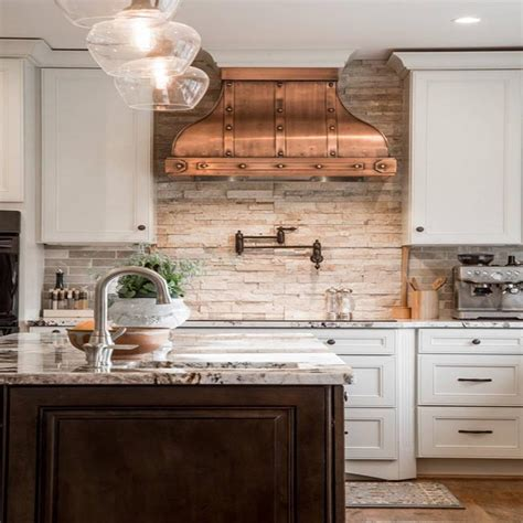 rocky mountain granite with white cabinets unique kitchen interior design white cabinets copper hood