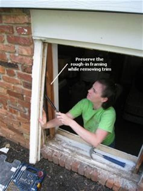 replacing windows in an old house installing replacement windows in a brick house and removing the old metal ones
