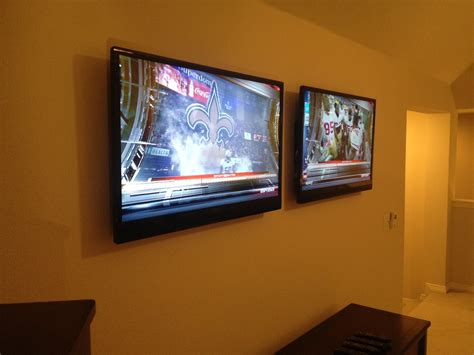 gameday will never be the same with these two tvs mounted in the room catch both your