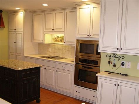 painting over painted kitchen cabinets kitchen cabinet makeover kitchen cabinets kitchen design