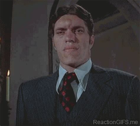 james bond gif when i have to smile for a family picture jaws james