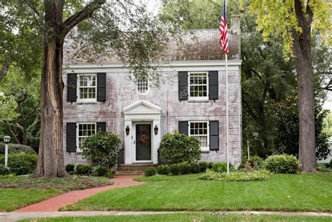 white colonial house white brick georgian colonial house with flagpole stock