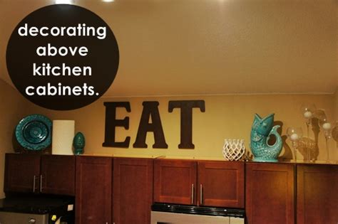 how to decorate top of kitchen cabinets pinterest decorating above the kitchen cabinets little lessons in