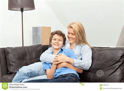 mom son couch mother and son sitting on a couch royalty free stock photo
