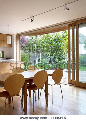 Dining Table In Front Of Doors Wood And Glass Sliding Doors In Arched Doorframe Chelsea