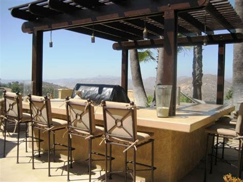 outdoor kitchen concrete counter top and bar seating with