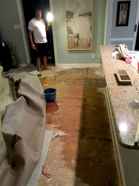 water under bathroom floor waking up to a flooded kitchen familyroom sand and sisal