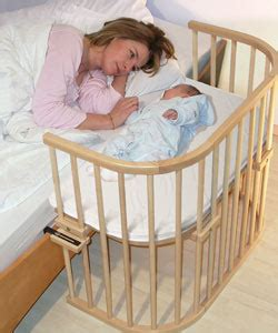 side crib attached to bed cosleeping what type of co sleeping product hangs off
