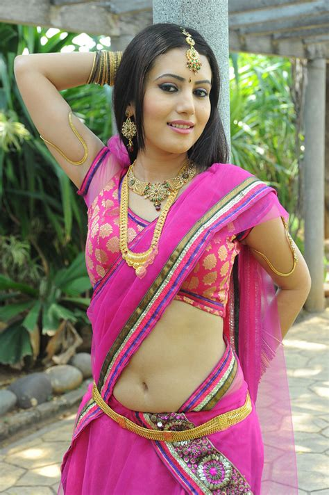 photos of heroine in saree anu smruthi dazzling photos in half saree at heroine movie