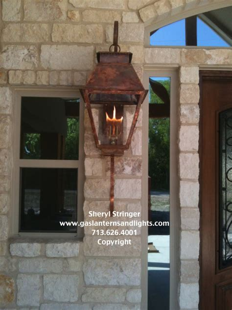 gas lantern outdoor lighting hill country style home with gas lanterns traditional