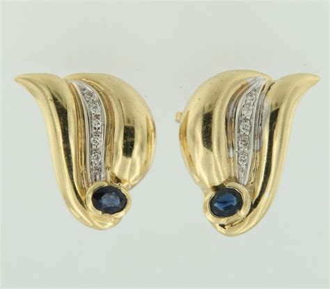 Expedition E6669 Gold Original E 6669 18 kt bi colour gold stud earrings set with sapphire and catawiki
