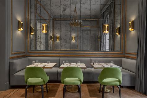 Luxury Dining Room restaurant with antiqued mirror wall