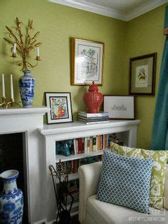 classic simple family room rebecca driggs hgtv built ins around fireplace and windows design ideas