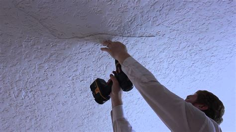 ceiling plaster repair on a small buckling