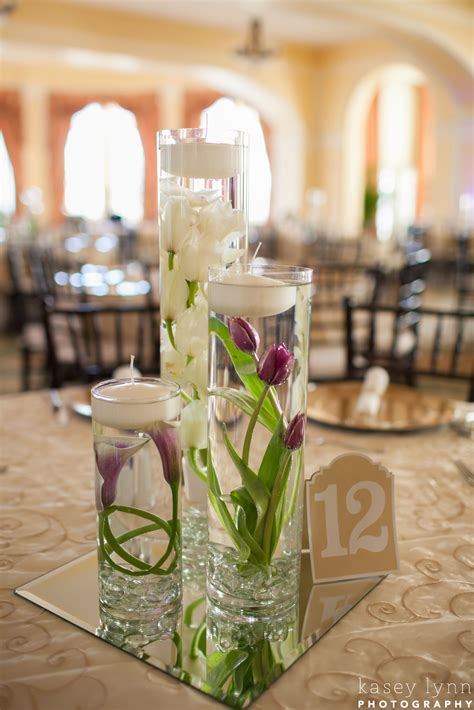 submerged flower centerpieces white orchid purple tulips
