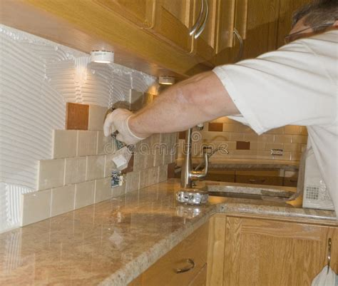 install tile backsplash kitchen ceramic tile installation on kitchen backsplash 12 royalty free stock photos image 13321318