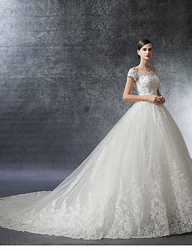 beading on the wedding dress to the right reminds me of indian a line off the shoulder cathedral train satin wedding
