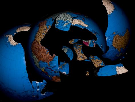 the world broke in earth shattering a broken globe that was helped on its wa flickr