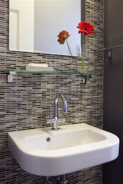 Wall mounted sink w patterned tile contemporary bathroom