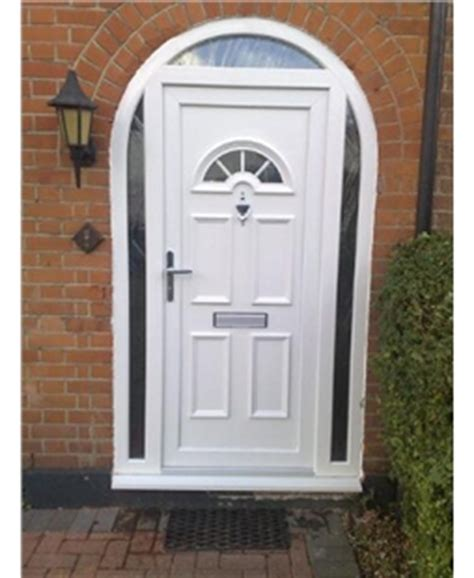 white upvc door in arched frame with glazed surround